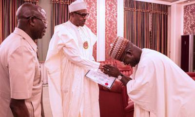 All smiles as Bello presents certificate of return to Buhari