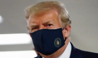 US President Trump wears face mask in public for first time
