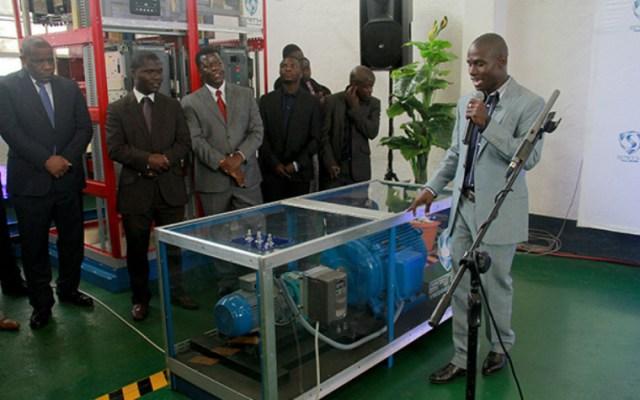 Sangulani Chikumbutso explains to visitors how the Permanent Magnetic Converter works during a presentation. Photo: Aaron Ufumeli
