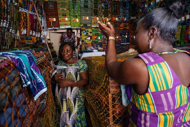 Bolts of GTP cloth, made by the Dutch luxury fabric company Vlisco, shown in a store owned by Perpetual Owusu-Agyemang. She's seen counterfeit versions selling for a fraction of the wholesale price, just down the road. Photographer: Nana Kofi Acquah