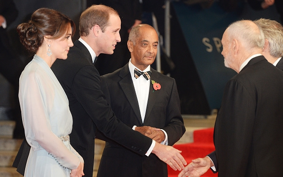 LONDON, ENGLAND - OCTOBER 26:  (L-R) Catherine, Duchess of Cambridge and Prince William, Duke of Cambridge greet Michael G Wilson during the Royal World Premiere of 'Spectre' at Royal Albert Hall on October 26, 2015 in London, England.  (Photo by Dave J Hogan/Dave J Hogan/Getty Images)