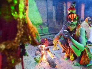 A Nepalese Sadhu paints his face for Maha Shivaratri in Kathmandu