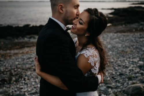 Dark and moody photo of a bride and groom on the Rising Tide Society and HoneyBook blog