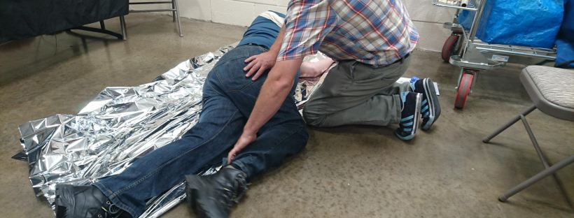 First Aid, Recovery Position, Blue gloves, space blanket, Foil blanket
