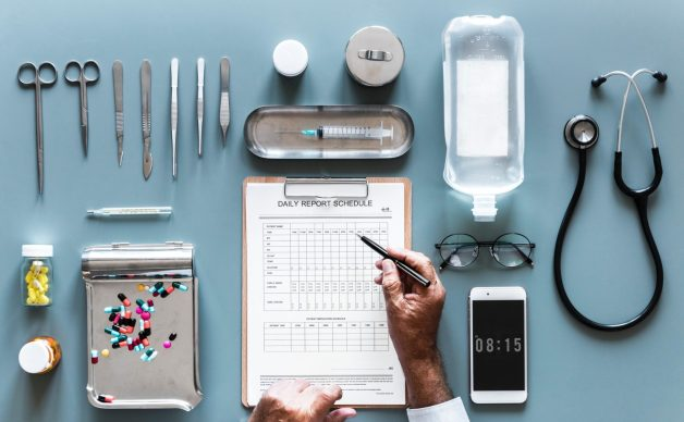 An image of medical supplies and a daily report schedule