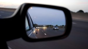 a rear view mirror and a highway