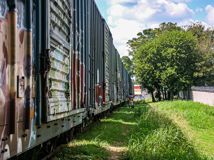 Roadside Relics - Train Shadows Looming Man Alone