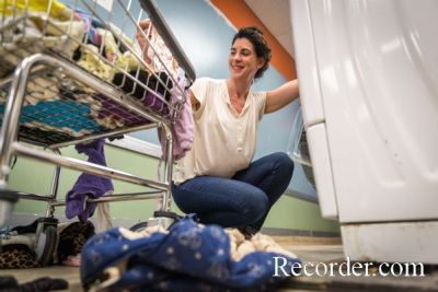 Image of Director Suzanne LoManto at Suzee's Third Street Laundry