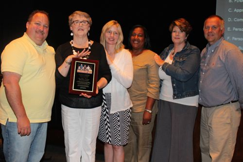 Retiring school board president Ann Cotten-DeGrasse was acknowledged by fellow board members at last week's meeting. Pictured, from left: board vice president Greg Meyer, Cotten-DeGrasse, Sue Koukounas, Kimberly Ligon, Amy Lantz and Christopher Dorr.