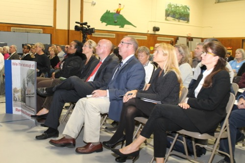 The Southampton Town Board view a presentation by Renaissance Downtowns during a public hearing at the Phillips Avenue school Oct. 29,