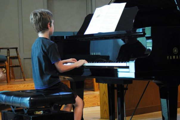 Future Drum Student playing piano