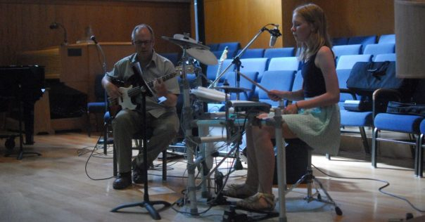 Preteen Girl Drum Student with Teacher on Bass