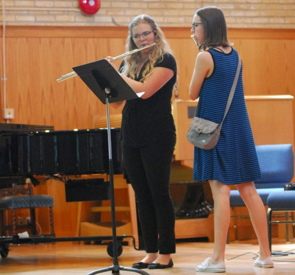 Teen Flute Playing With Teacher
