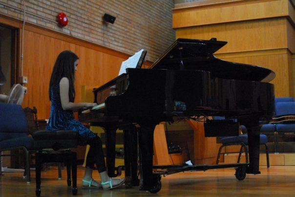 Teen piano playing