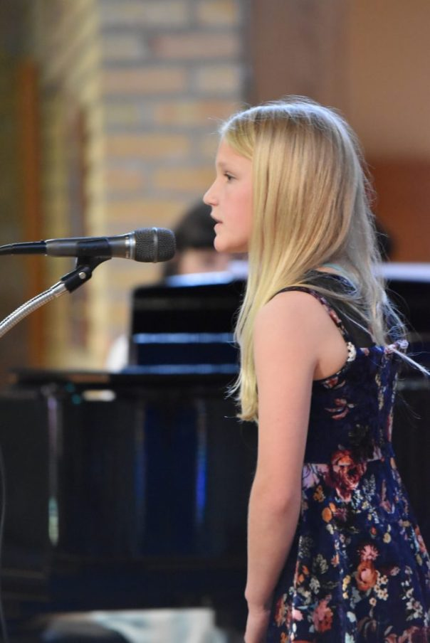 Young Girl Singing at recital
