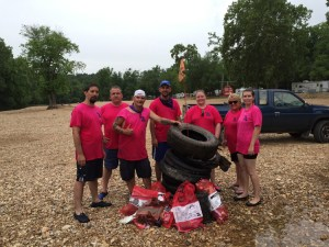 Members of the AT&T Stream Team chapter in Joplin, Mo., and one of their recent hauls from a local river.