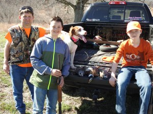 "Happy Hunters - Andrew Moritz, 14, (left) and Tyler Mortiz, 10, (right) display their bounty of the day. The boys bagged pheasants and chuckers with guide Aaron Meredith at the Young Outdoorsmen United ""Featherfest"" event. The Moritz brothers live in Rocky Comfort."