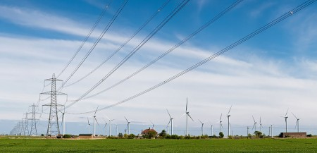 1024px-Wind_Turbines_and_Power_Lines,_East_Sussex,_England_-_April_2009