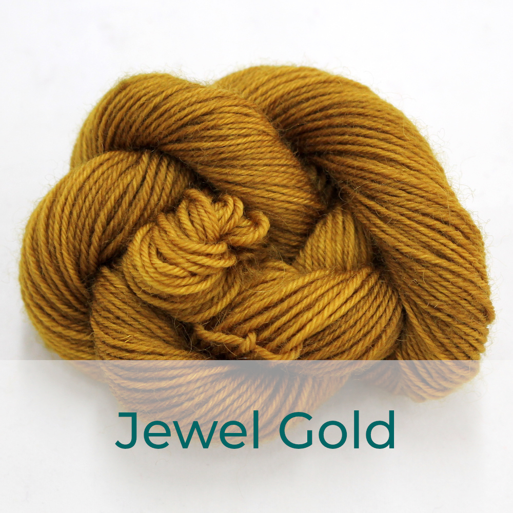 BFL 4 Ply mini skein in the Jewel Gold colourway. It is a mustard colour.