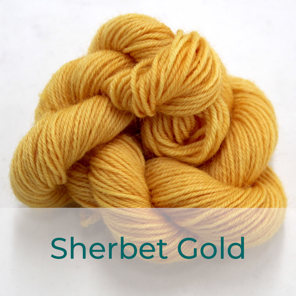 BFL 4 Ply mini skein in the Sherbet Gold colourway. It is pale orange-yellow.