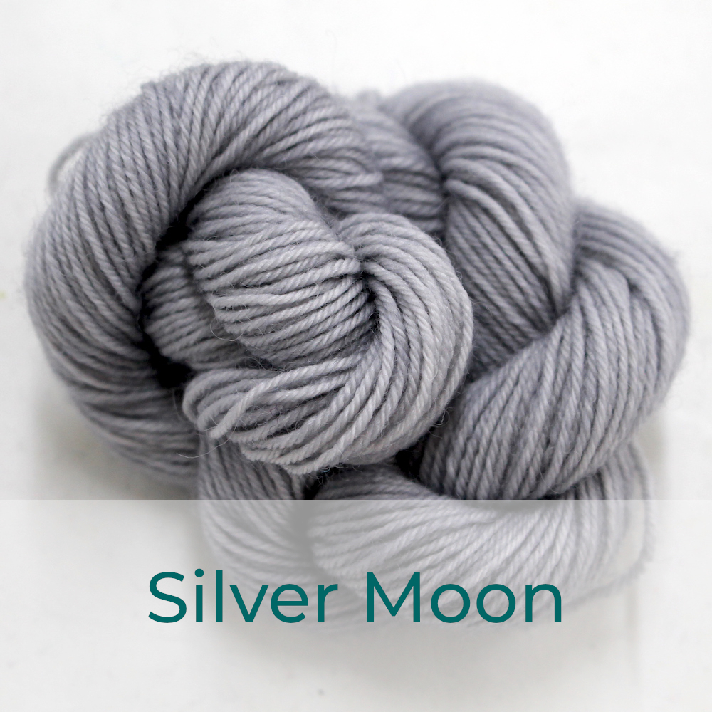 BFL 4 Ply mini skein in the Silver Moon colourway. It is light grey.