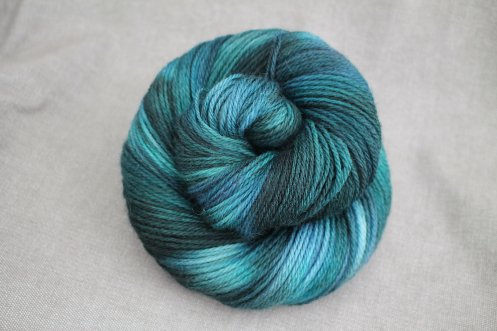 A skein of Lyn DK in the Gathering colourway