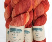 Skeins of Feisty Fox - a burnt orange and red colourway