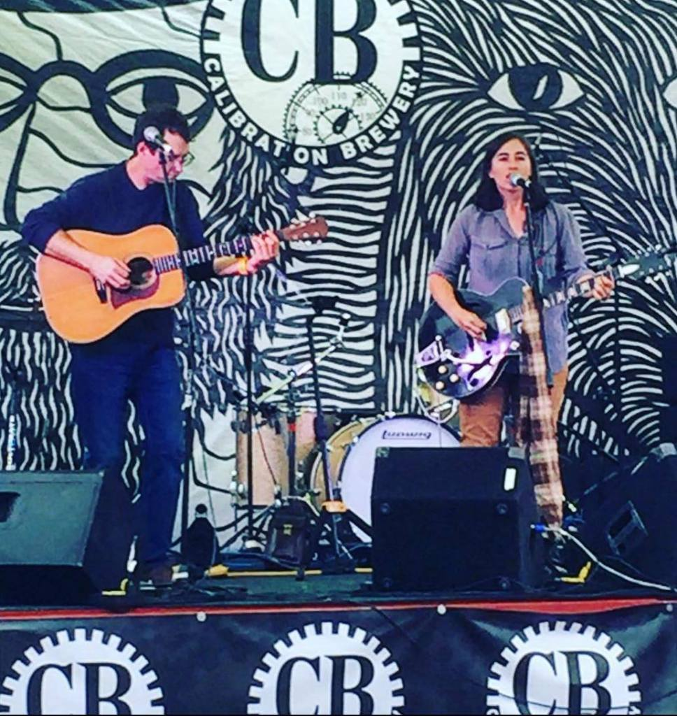 Live music on outdoor stage at Calibration Craft brewery.