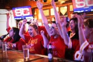 Chiefs fans cheer on their team at Chappell's Restaurant and Sports Museum, a Kansas City sports bar