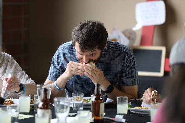 Diner chowing down on Smokin Guns BBQ
