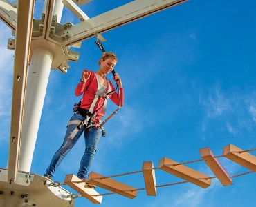 Image of girl on SandRidge Sky Trail ropes course