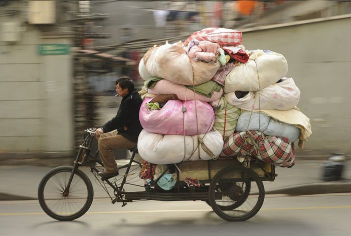 A man transports clothing for recycling