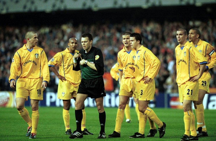 8 May 2001: The Leeds player surround the referee Urs Meier after Juan Sachez scored a controversial goal during the match between Valencia and Leeds United in the UEFA Champions League semi-final, second leg at Mestalla, Camp Del Valencia, Valencia, Spain. Mandatory Credit: Stu Forster/ALLSPORT