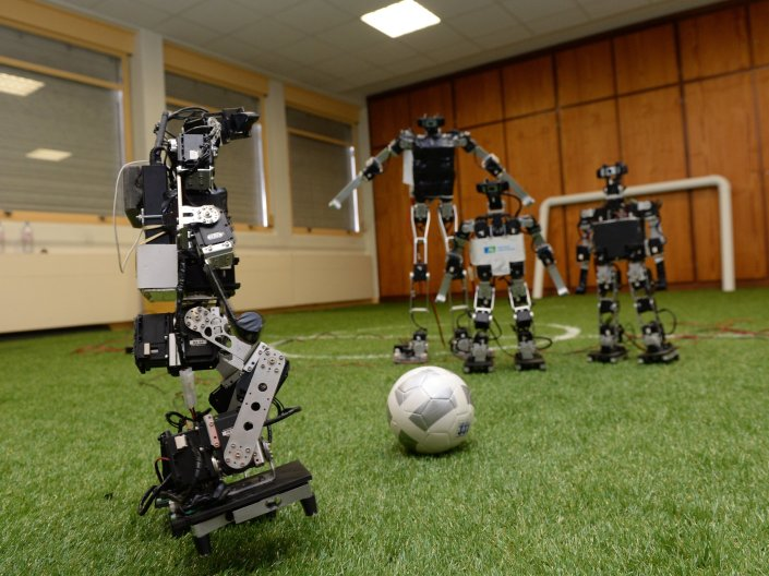 TO GO WITH AFP STORY BY LAURENT BANGUET - Robots play football at the LABRI Laboratory (computer science research center) in Bordeaux on July 3, 2015. These robots will defend the colors of France in the next World Robotics competition 'RoboCup' , held in China from July 19 to 23. AFP PHOTO / JEAN PIERRE MULLER (Photo credit should read JEAN-PIERRE MULLER/AFP/Getty Images)
