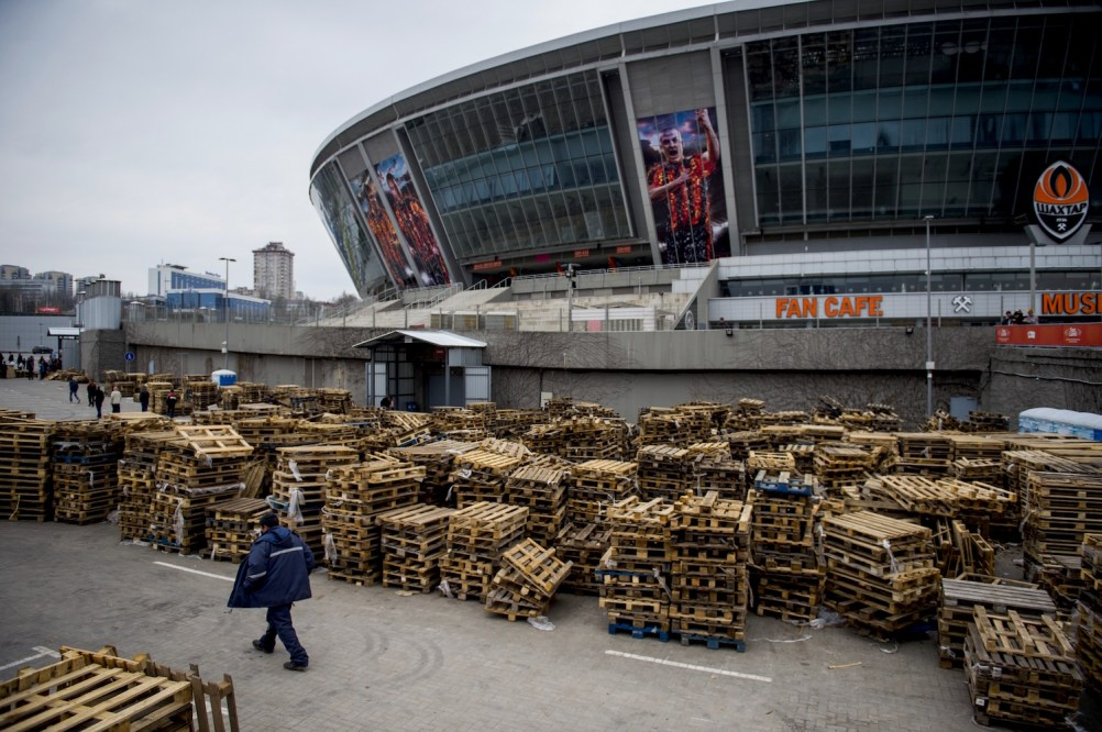 Empty pallets are seen outside the Donbass Stadium, home of the Shaktar Donetsk football club on April 14, 2015 in Donetsk, in the self-proclaimed Donetsk People's Republic (DNR). The football club which was knocked out of the Champions League in the round of 16 is distributing food parcels from the now idle stadium. The club's owner Ukrainian oligarch Renat Akhmetov through his foundation have 2,000 volunteers delivering some 20,000 food parcels a day for people in need from 29 distribution centers across the Donetsk region. AFP PHOTO / ODD ANDERSEN (Photo credit should read ODD ANDERSEN/AFP/Getty Images)