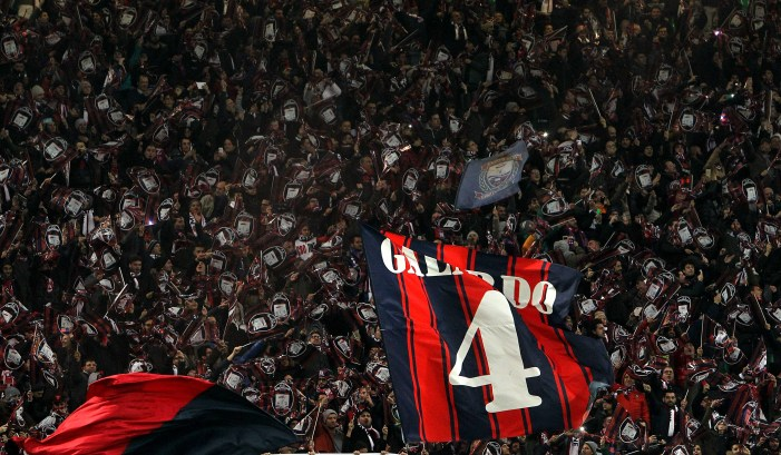 MILAN, ITALY - DECEMBER 01: The FC Crotone fans show their support before the TIM Cup match between AC Milan and FC Crotone at Stadio Giuseppe Meazza on December 1, 2015 in Milan, Italy. (Photo by Marco Luzzani/Getty Images)