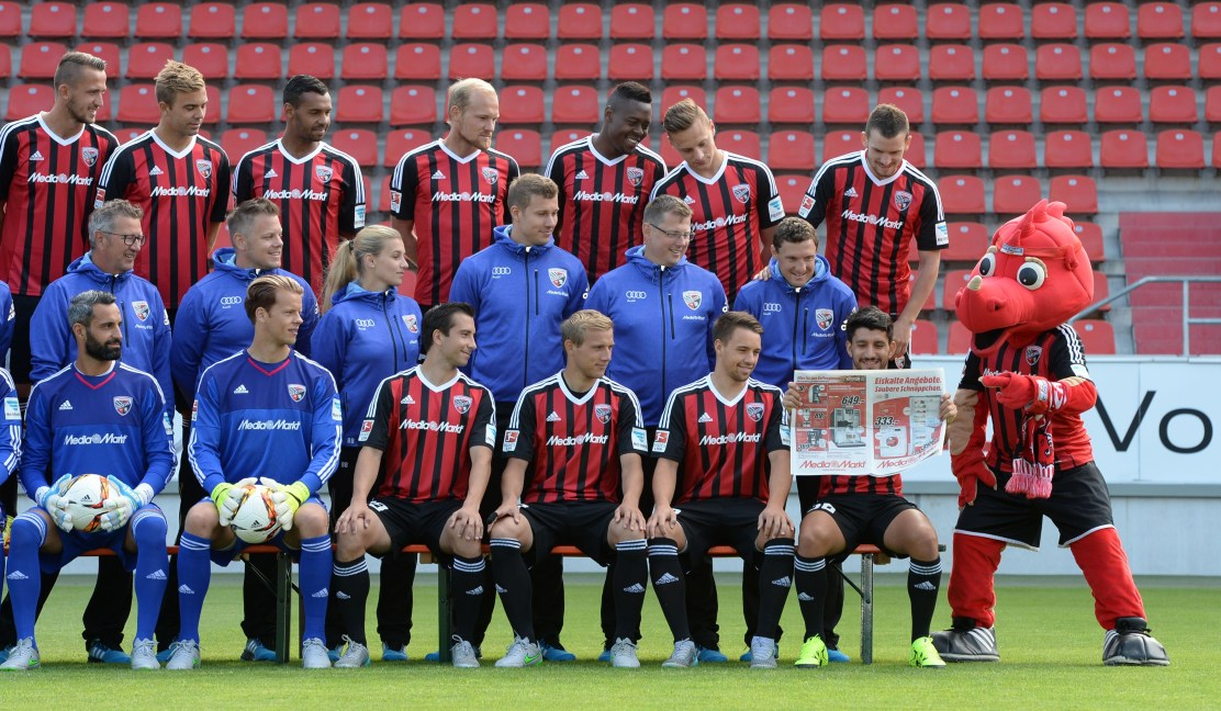 "The German first division Bundesliga team of FC Ingolstadt 04 and their mascot ""Schanzi"" pose during the team presentation of the German first division Bundesliga team FC Ingolstadt 04 at the stadium in Ingolstadt, southern Germany, on July 9, 2015. AFP PHOTO / CHRISTOF STACHE (Photo credit should read CHRISTOF STACHE/AFP/Getty Images)"