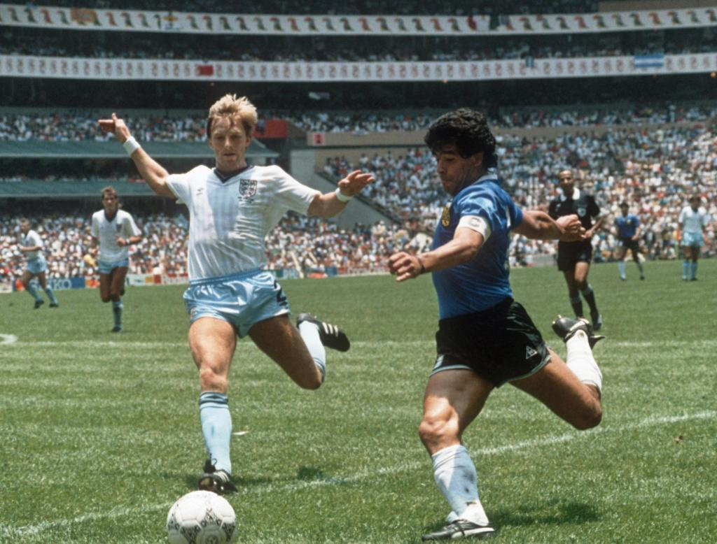 Argentinian forward Diego Maradona (R) gets ready to cross the ball under pressure from English defender Gary Stevens during the World Cup quarterfinal soccer match between Argentina and England 22 June 1986 in Mexico City. Argentina beat England 2-1 on goals by Maradona. AFP PHOTO (Photo credit should read STAFF/AFP/Getty Images)