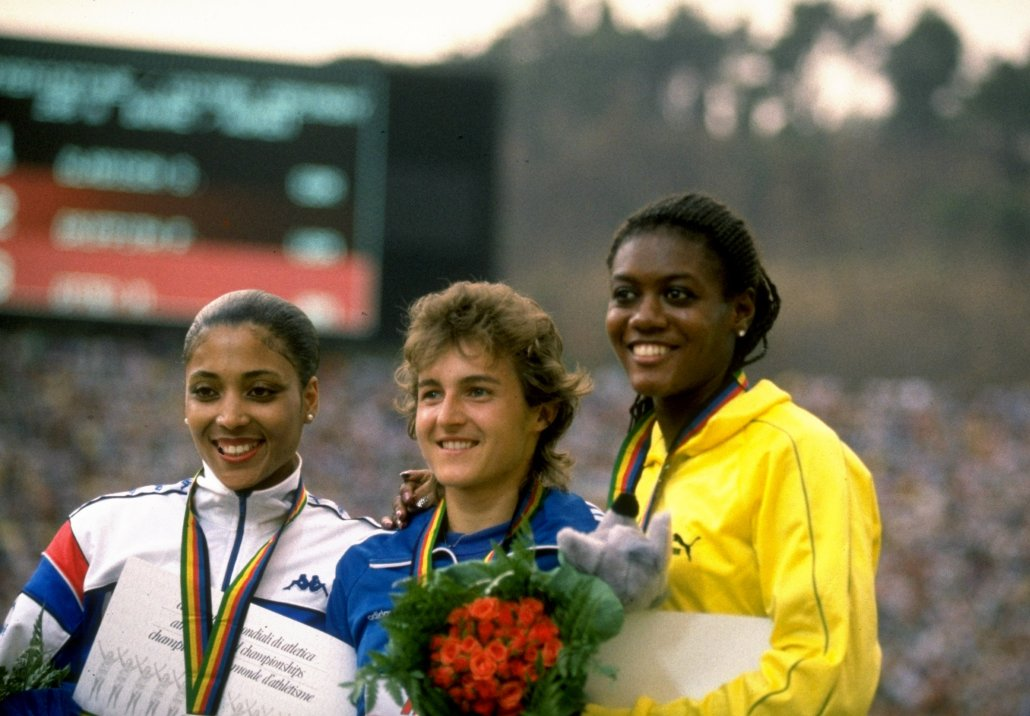 3 Sep 1987: Silke Gladisch (centre) of East Germany on the podium after the 200m with Merlene Ottey of Jamaica (right) and Florence Griffith Joyner of the USA (left) during the World Championships at the Olympic Stadium in Rome. Gladisch won Gold. Mandatory Credit: Tony Duffy/Allsport