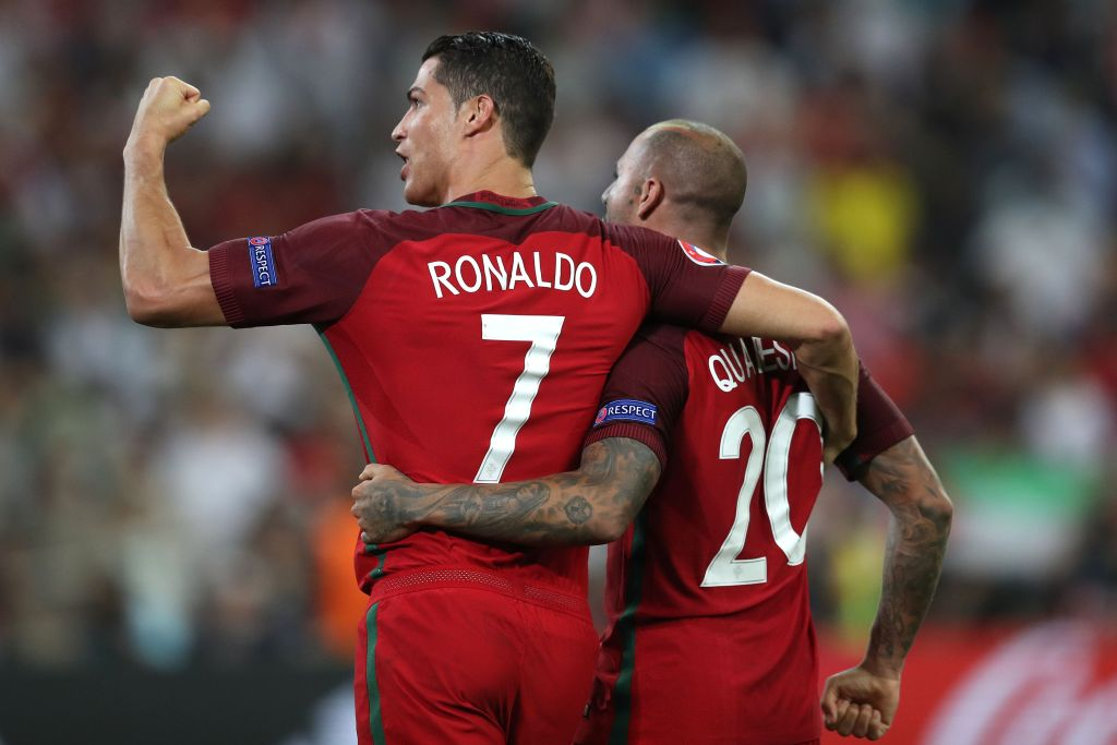 Portugal's forward Cristiano Ronaldo and Portugal's forward Ricardo Quaresma celebrate after winning the Euro 2016 quarter-final football match between Poland and Portugal at the Stade Velodrome in Marseille on June 30, 2016. / AFP / Valery HACHE (Photo credit should read VALERY HACHE/AFP/Getty Images)