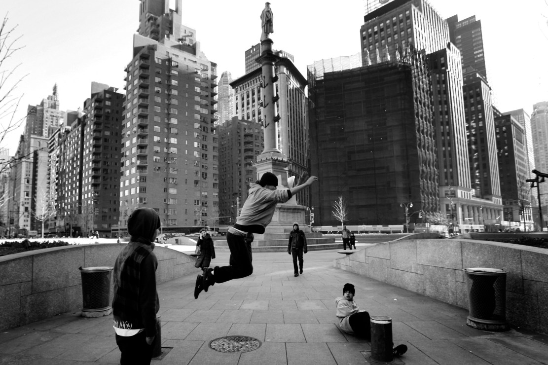 """NEW YORK - FEBRUARY 3 : """" Aim """" leaps a pole gap while practicing Parkour February 3, 2007 at Columbus Circle, New York City. Parkour is the art of fluid and efficient movement over obstacles or objects within your path, using only the capabilities of the human body. The art was developed with French soldiers during Vietnam and was later refined in the town of Lisse, France. Parkour has seen a large increase in particapants looking for a new fun form of fitness and wellbeing and has enjoyed recent popularity through movies such as District B13 and Casino Royale which all used Parkour in major action scenes. (Photo by Chris McGrath/Getty Images)"""