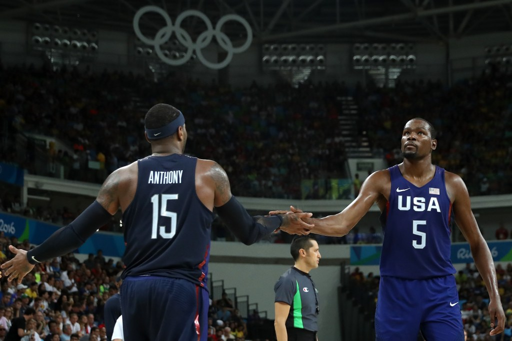 RIO DE JANEIRO, BRAZIL - AUGUST 19: Carmelo Anthony #15 and Kevin Durant #5 of United States celebrate a play against Spain during the Men's Semifinal match on Day 14 of the Rio 2016 Olympic Games at Carioca Arena 1 on August 19, 2016 in Rio de Janeiro, Brazil. (Photo by Christian Petersen/Getty Images)