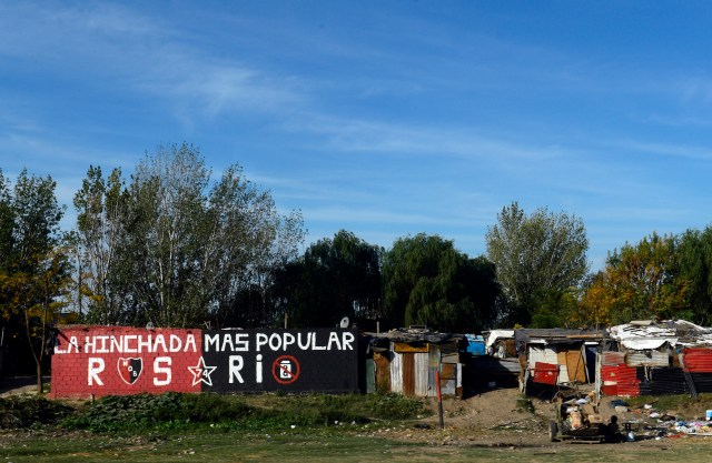 A graffiti cheering Argentine first division football club Newell's Old Boys is seen at a shantytown near the city of Rosario, Argentina on May 14, 2013. Rosario, the city where Argentine football star Lionel Messi was born, regained the sport splendor of old times while Newell's is beginning to look like the new champion of Argentine First Division championship and Rosario Central to return to the First Division tournament. AFP PHOTO / DANIEL GARCIA (Photo credit should read DANIEL GARCIA/AFP/Getty Images)