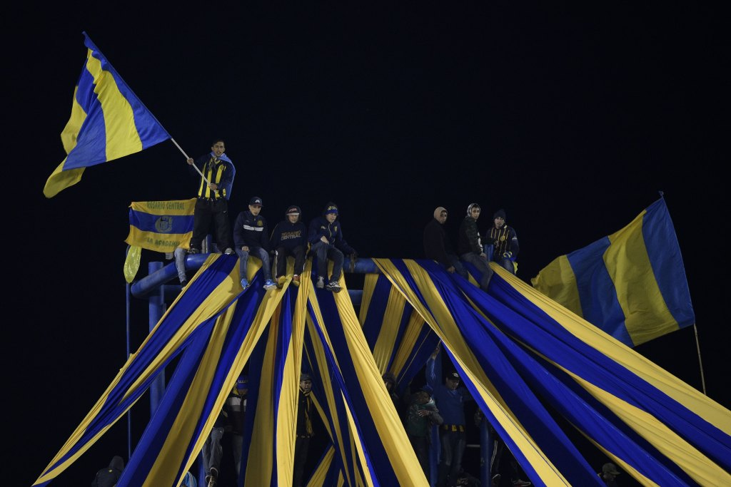 """Argentina's Rosario Central supporters cheer for their team during the Copa Libertadores 2016 quarterfinals first leg football match against Colombia's Atletico Nacional at the """"Gigante de Arroyito"""" stadium in Rosario, Santa Fe, Argentina, on May 12, 2016. / AFP / JUAN MABROMATA (Photo credit should read JUAN MABROMATA/AFP/Getty Images)"""