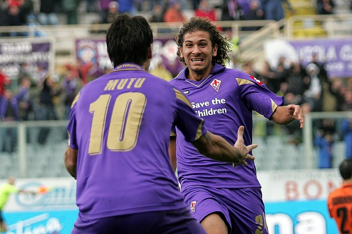 FLORENCE, ITALY - NOVEMBER 07: Alessio Cerci (R) and Adrioan Mutu (L) of ACF Fiorentina celebrate after scoring a goal during the Serie A match between Fiorentina and Chievo at Stadio Artemio Franchi on November 7, 2010 in Florence, Italy. (Photo by Gabriele Maltinti/Getty Images)