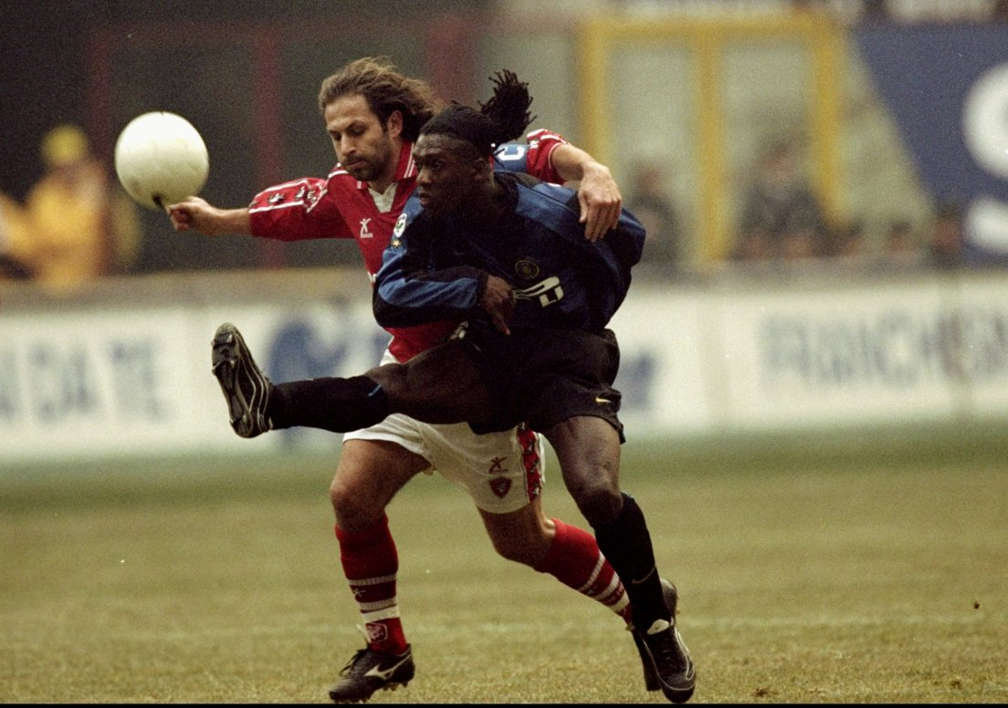 6 Jan 2000: Clarence Seedorf of Inter Milan battles with Renato Olive of Perugia during the Serie A match played at the San Siro in Milan, Italy. Inter won the game 5-0. Mandatory Credit: Claudio Villa /Allsport