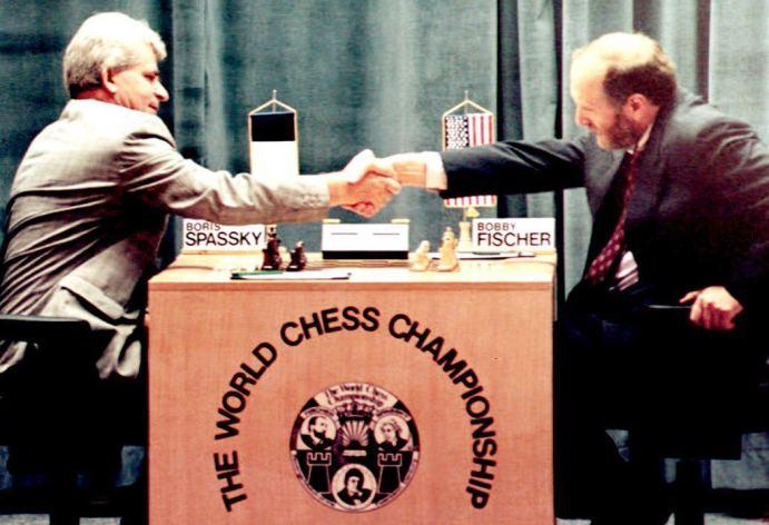 Russian-born chess master Boris Spassky (L) shakes