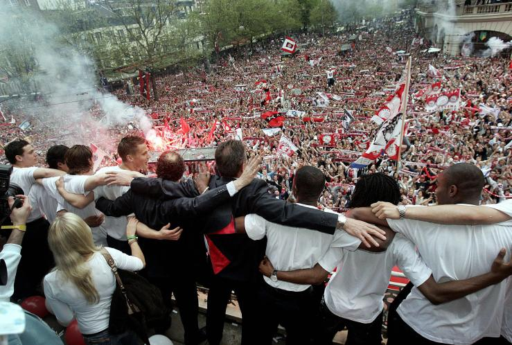 Ajax Amsterdam's players celebrate after