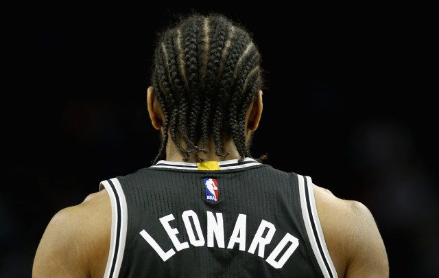 CHARLOTTE, NC - MARCH 21: Kawhi Leonard #2 of the San Antonio Spurs watches on against the Charlotte Hornets during their game at Time Warner Cable Arena on March 21, 2016 in Charlotte, North Carolina.NOTE TO USER: User expressly acknowledges and agrees that, by downloading and or using this photograph, User is consenting to the terms and conditions of the Getty Images License Agreement. (Photo by Streeter Lecka/Getty Images)
