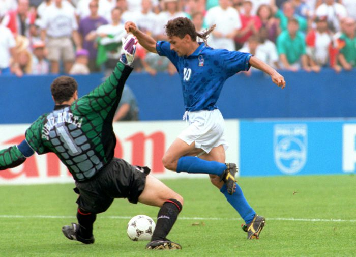 Italian forward Roberto Baggio (R) dribbles past S